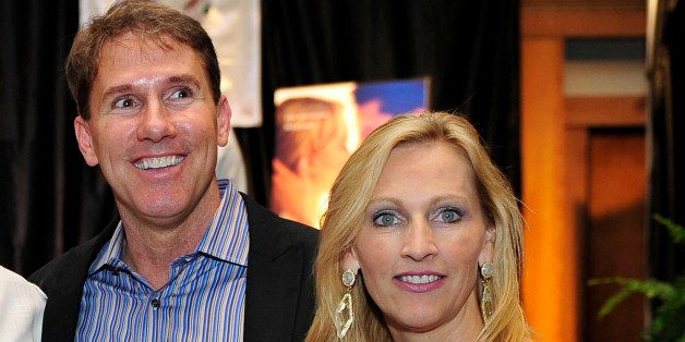 From left, ESPN anchor Hannah Storm, actor Hill Harrow, author Nicholas Sparks and his wife Cathy pose for a photo at a fan lunch at the inaugural Nicholas Sparks Celebrity Family Weekend on April, 20, 2012 in New Bern, North Carolina.  The weekend includes a celebrity golf tournament, a 5K run, boat tours, a family fun night, and a screening of Sparks' new film The Lucky One.  The weekendᅢ까タᅡルs proceeds will benefit the Nicholas Sparks Foundation, which supports global education initiatives for youth through the Epiphany School in New Bern, NC, wounded warriors through Hope for the Warriors, and assistance dogs for people with disabilities through Paws With a Cause. (AP Photo/ Nicholas Sparks, WhoSay)