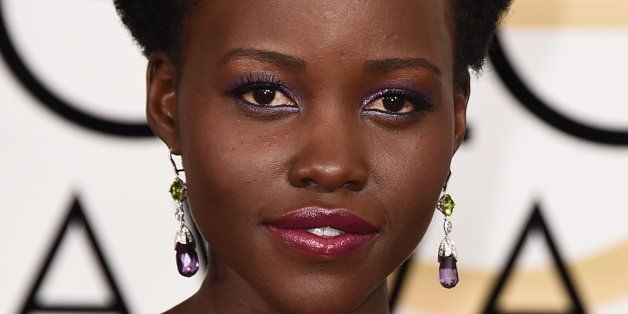 Lupita Nyong'o arrives at the 72nd annual Golden Globe Awards at the Beverly Hilton Hotel on Sunday, Jan. 11, 2015, in Beverly Hills, Calif. (Photo by Jordan Strauss/Invision/AP)