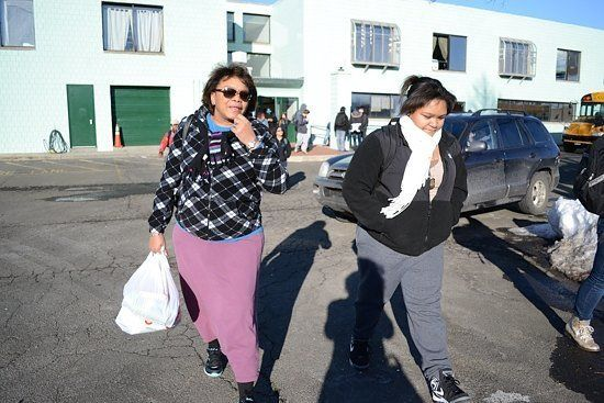 Nikita Rodriguez, who's 14, gets up at 4:30 a.m. with her mom Nilda Paris in their apartment in Bridgeport's East End. New Ha