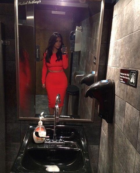 Bathroom selfie wearing Kardashian Kollection in Sears now
