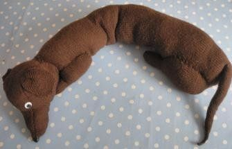 A sausage dog draught excluder to put inside the house at the bottom of the front door.