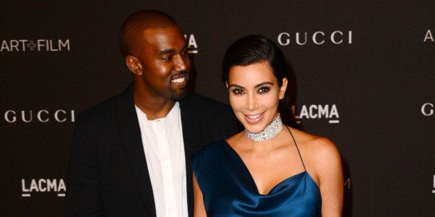Kanye West, left, and Kim Kardashian arrive at the LACMA Art + Film Gala at LACMA on Saturday, Nov. 1, 2014, in Los Angeles. (Photo by Jordan Strauss/Invision/AP)