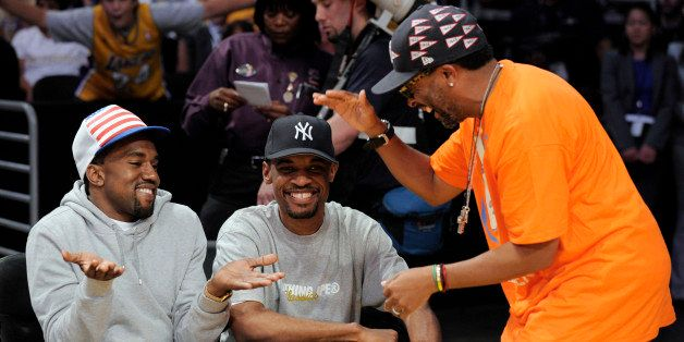 Kanye West, left, talks with filmmaker Spike Lee, right, and an unidentified friend before Game 3 of the NBA basketball finals between the Boston Celtics and Los Angeles Lakers on Tuesday, June 10, 2008, in Los Angeles. (AP Photo/Mark J. Terrill)