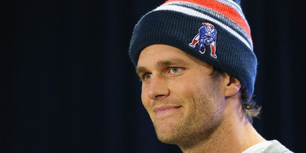 FOXBORO, MA - JANUARY 22: New England Patriots quarterback Tom Brady talks to the media during a press conference to address the under inflation of footballs used in the AFC championship game at Gillette Stadium on January 22, 2015 in Foxboro, Massachusetts.  (Photo by Maddie Meyer/Getty Images)
