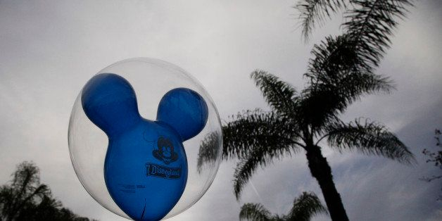 A man holds a balloon at Disneyland, Thursday, Jan. 22, 2015, in Anaheim, Calif. A major measles outbreak traced to Disneyland has brought criticism down on the small but vocal movement among parents to opt out of vaccinations for their children. (AP Photo/Jae C. Hong)