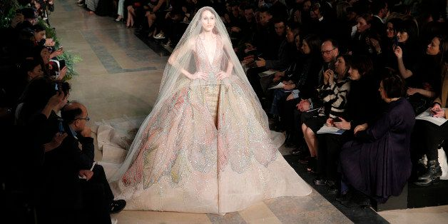 A model wears a creation by fashion designer Elie Saab during his Spring-Summer 2015 Haute Couture fashion collection, presented in Paris, France, Wednesday, Jan. 28, 2015. (AP Photo/Christophe Ena)