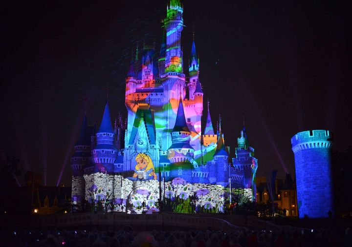 Images of Disney characters are projeted on the Cinderella castle at a press preview of the new attraction 'Once upon a time' at Tokyo Disneyland in Urayasu, suburban Tokyo on May 26, 2014. Disney theme park will start the new attraction using projection mapping from May 29.  AFP PHOTO / Yoshikazu TSUNO        (Photo credit should read YOSHIKAZU TSUNO/AFP/Getty Images)
