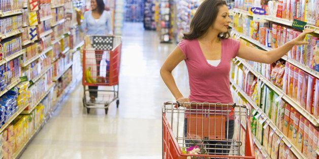 women grocery shopping in...