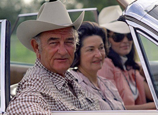 """LBJ's recreational activity of choice? Tearing around his Texas ranch in a station wagon while sipping <a href=""""http://liquor"""