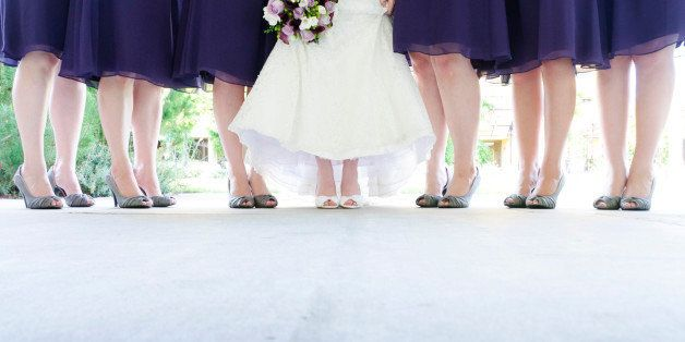 Six bridesmaid and bride standing.