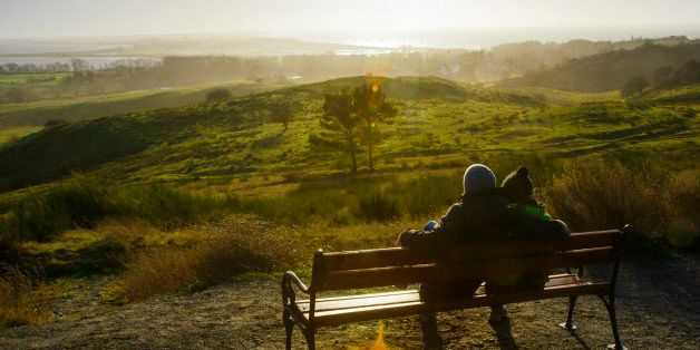 KLOSTER, GERMANY - JANUARY 02: Couple sitting on a bench on a hill and viewing over the Island Hiddensee January 02, 2015 in Kloster, Germany. Hiddensee is a car-free island in the Baltic Sea, located west of Germany's largest island, Ruegen, on the German coast. (Photo by Thomas Trutschel/Photothek via Getty Images)