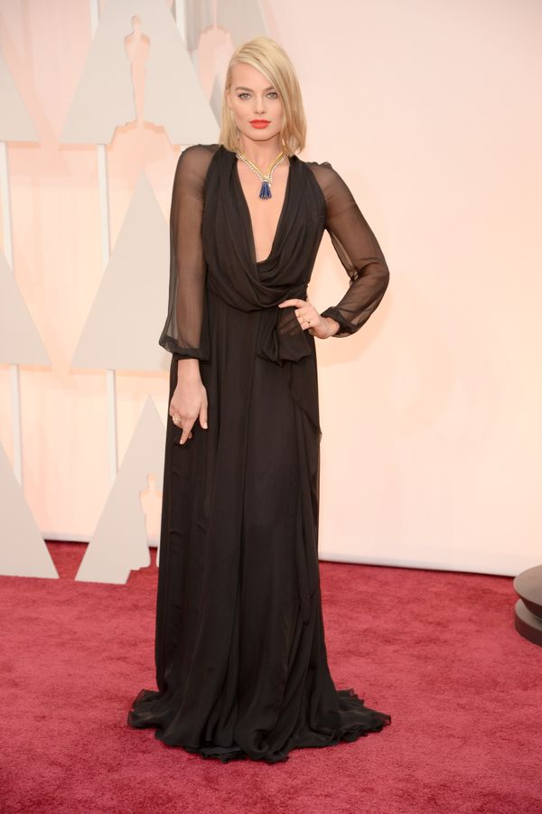 This dark and mysterious look isn't what we'd expect on the Oscar red carpet, but we love it on Margot. The gown's ease is th