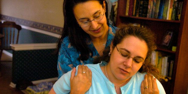 AURORA, CO (05-04-2006) -- Certified Labor Doula Ana Hill, left, is helping Leanne Stiles prepare for her upcoming birth. Ana assisted Leanne during her first pregnancy too. The word doula comes from the Greek word for the most important female slave or servant in an ancient Greek household, the woman who probably helped the lady of the house through her childbearing. (DENVER POST PHOTO BY KARL GEHRING)  (Photo By Karl Gehring/The Denver Post via Getty Images)