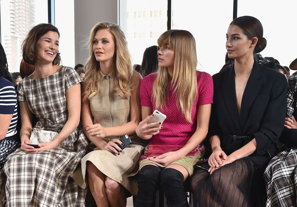 Hanneli Mustaparta, Poppy Delevingne, Jessica Hart, and Lily Aldridge attend the Michael Kors fashion show
