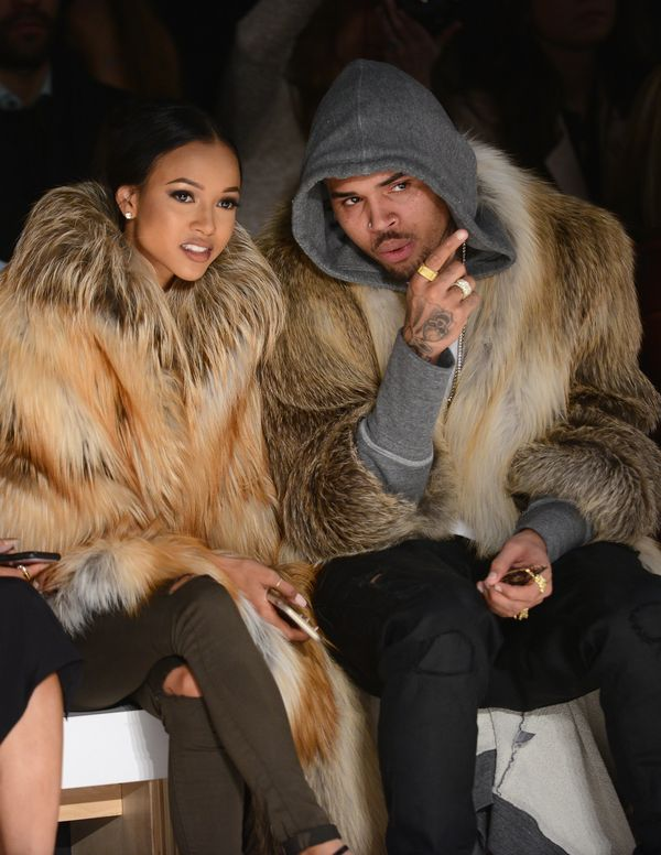 Karrueche Tran and Chris Brown attend the Michael Costello fashion show