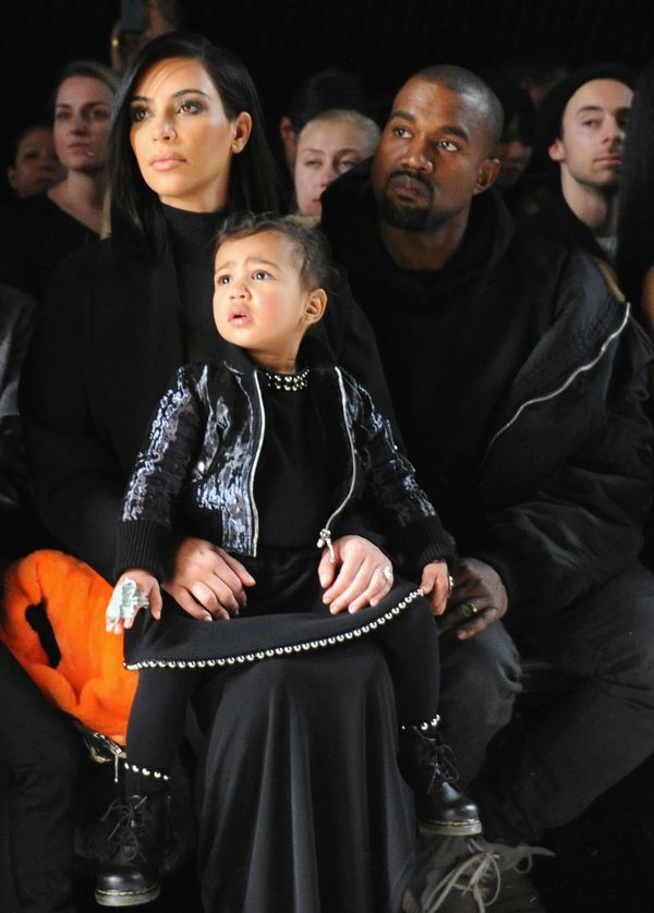 Kim Kardashian, North West and Kanye West attend the Alexander Wang Fashion Show