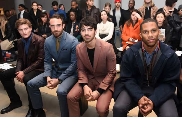 Oliver Cheshire, Joshua Sasse, Joe Jonas and Victor Cruz attend the Perry Ellis show