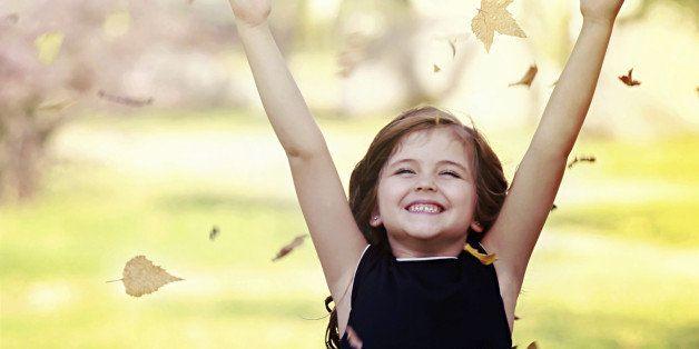 happy little girl in autumn