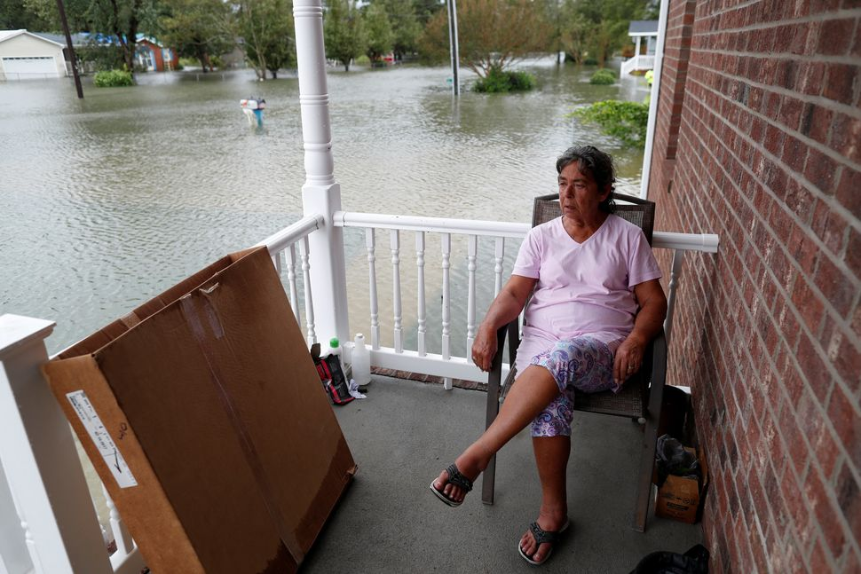 After just rebuilding her home from the floods of 2016, Willie Allen watches the water rise from her porch in Lumberton, Nort