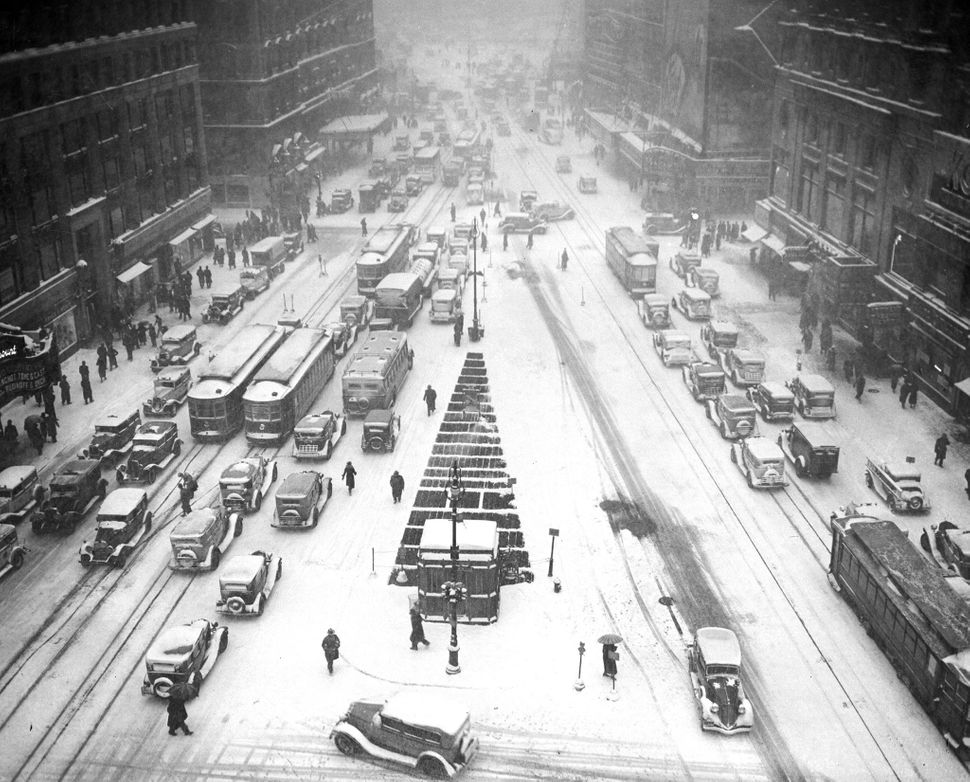 Times Square is covered in a white blanket during a snowstorm in 1935.