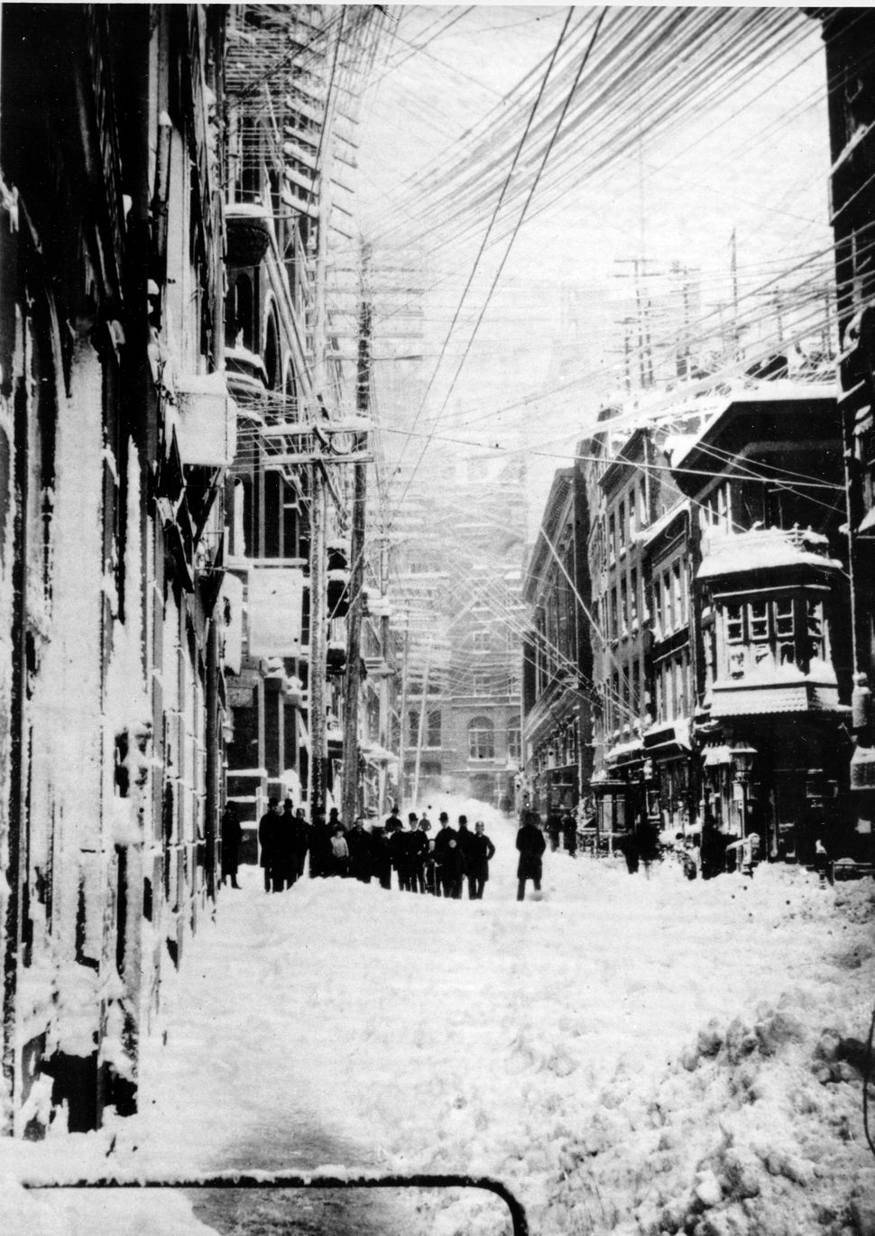 """A New York street is shown during the blizzard of 1888.  The blizzard that occured March 12-14 paralyzed the city with 40"""" of"""