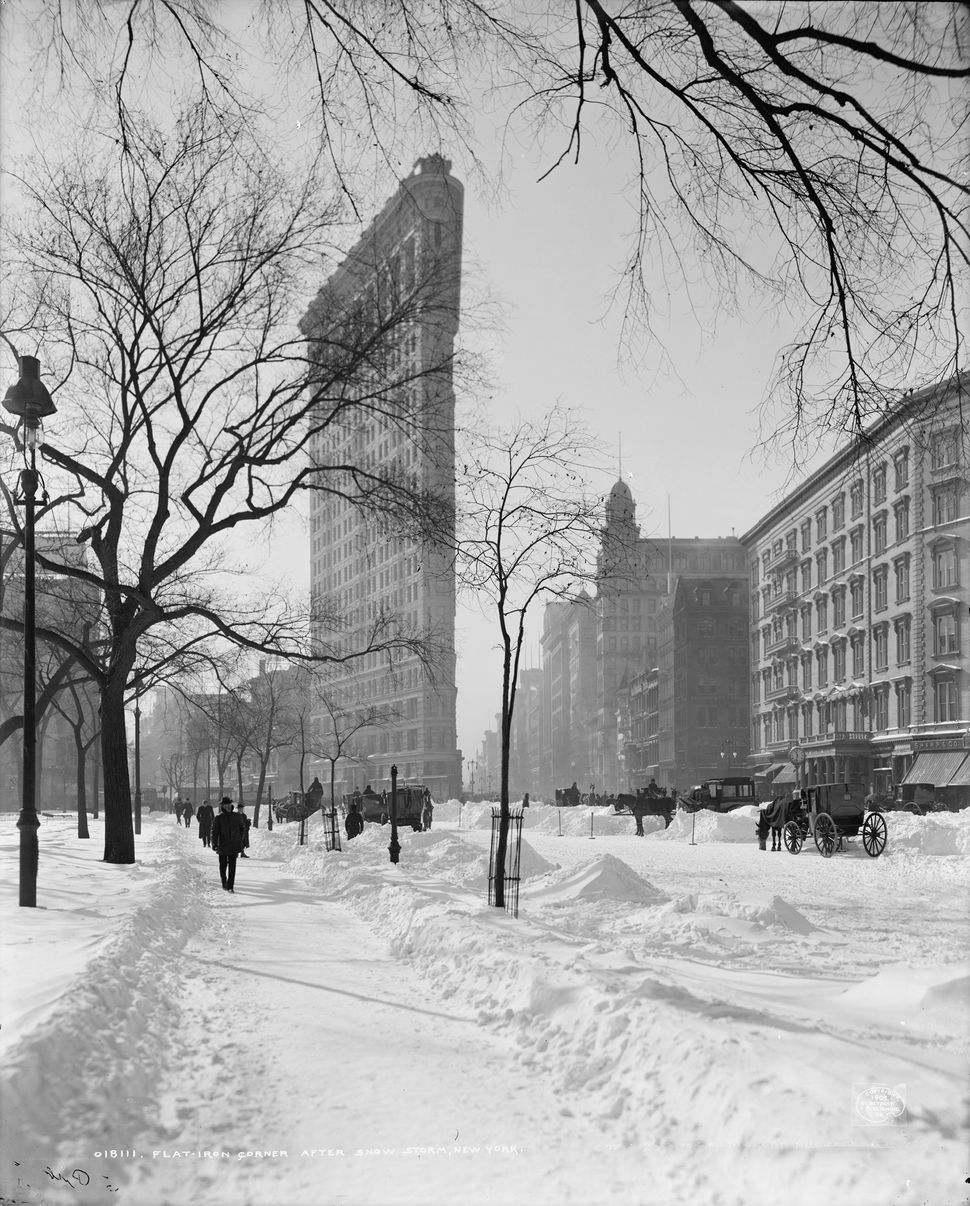 The Flatiron Building after a snowstorm in 1905.