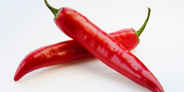 Close up of red chili peppers on white background