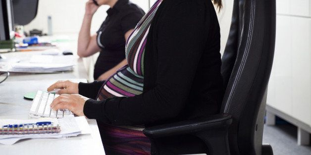 Pregnant women at a office