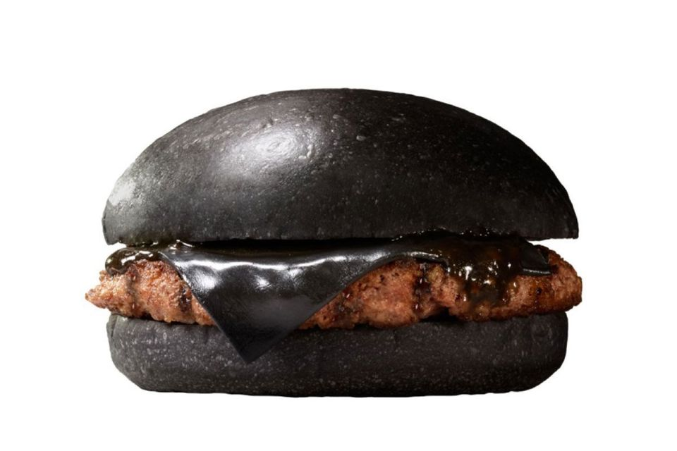 Go on, sink your teeth into a black cheese burger. You needn't add a thing -- it's loaded with black ketchup, too. <br><br>Do
