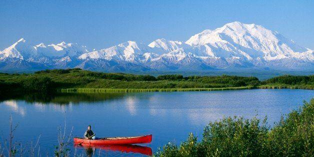 Canoeist on lake, Mount McKinley, Denali National Park, Alaska, USA.