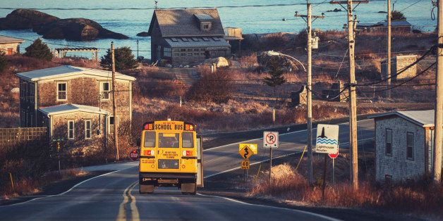 A school bus departs from a pickup on Nova Scotia's Lighthouse Route.