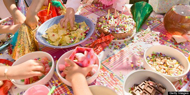 Children eating snacks at birthday party
