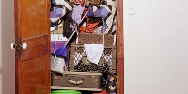 Closet packed with belongings