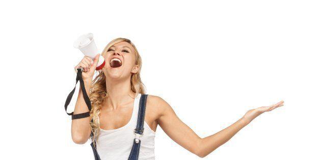 young blonde woman shouting...