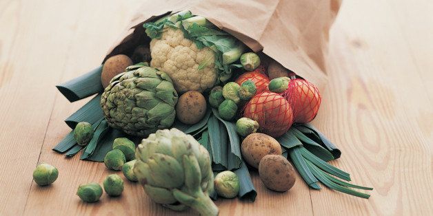 Paper Bag Full of Vegetables on a Table