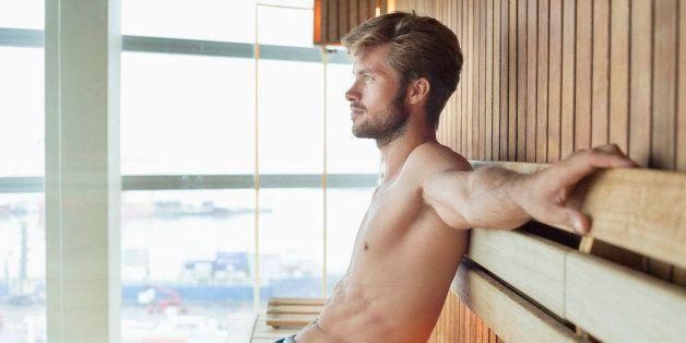 Man relaxing in a sauna