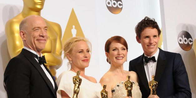 HOLLYWOOD, CA - FEBRUARY 22:  Actors J.K. Simmons;, Patricia Arquette, Julianne Moore and Eddie Redmayne pose inside the press room of the 87th Annual Academy Awards held at Loews Hollywood Hotel on February 22, 2015 in Hollywood, California.  (Photo by Albert L. Ortega/Getty Images)