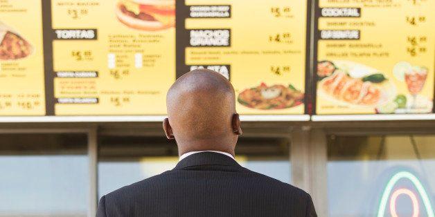 African American businessman looking at cafe menu
