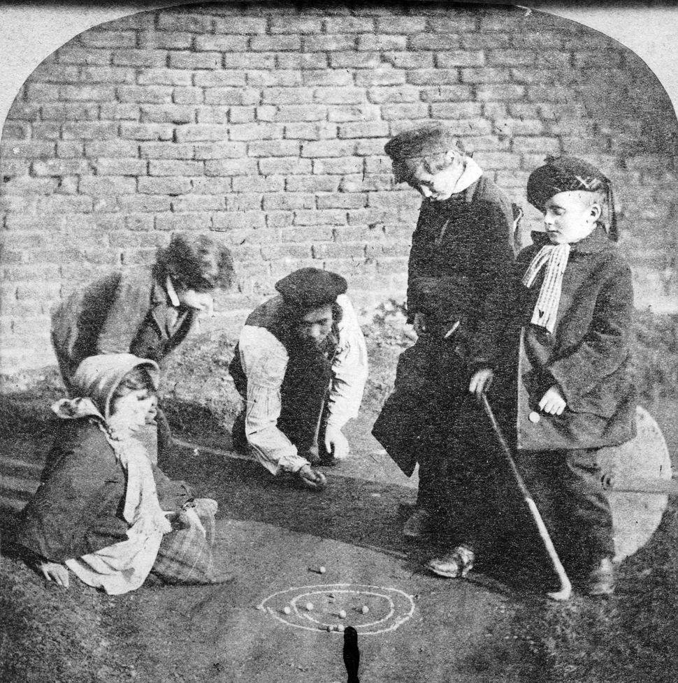 Circa 1855:  A group of children playing marbles.  (Photo by Hulton Archive/Getty Images)