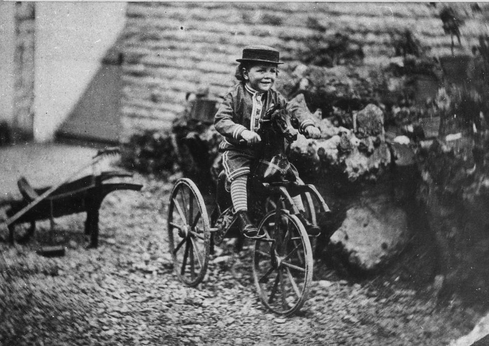 1870:  A child on a toy horse on wheels.  (Photo by Hulton Archive/Getty Images)