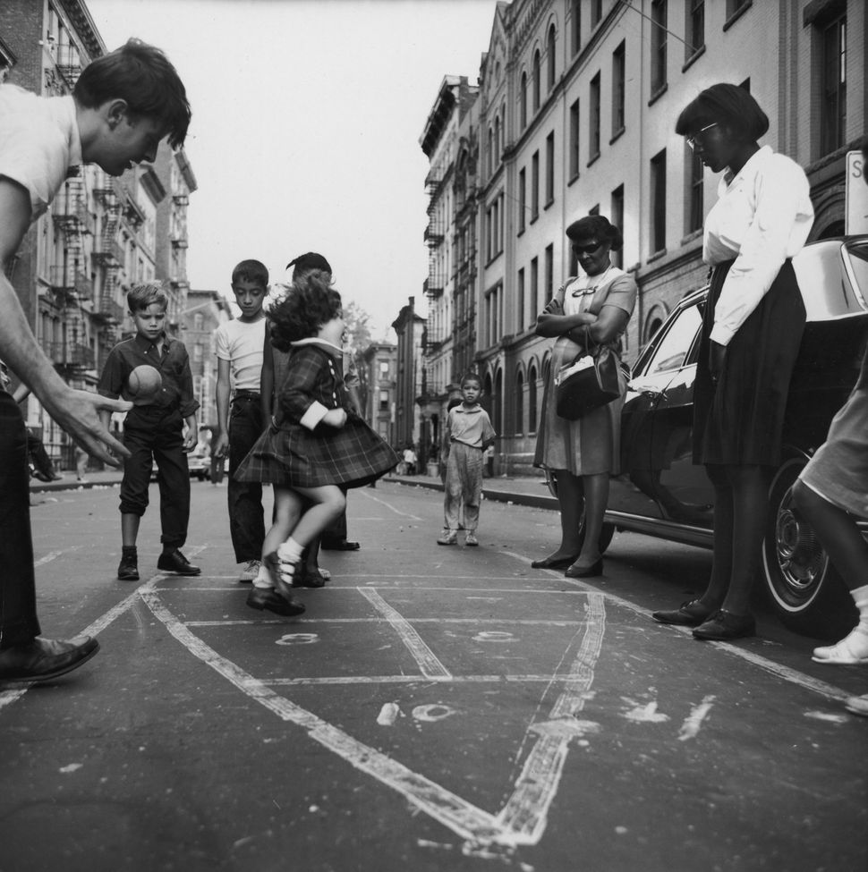 Circa 1965:  A view of children playing hopscotch in the street in Spanish Harlem (Photo by Hulton Archive/Getty Images)