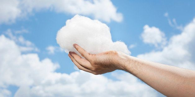 Hand holding a cloud.
