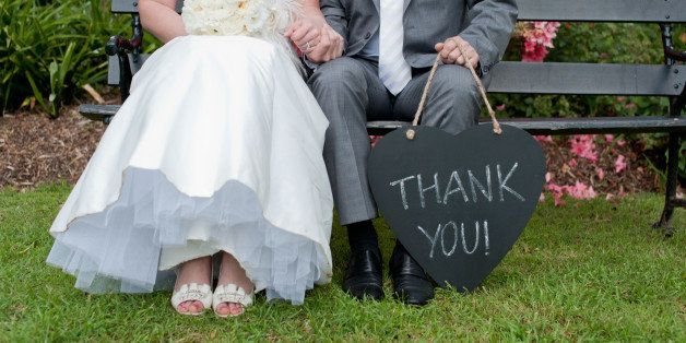 Bride & groom with Thank You sign