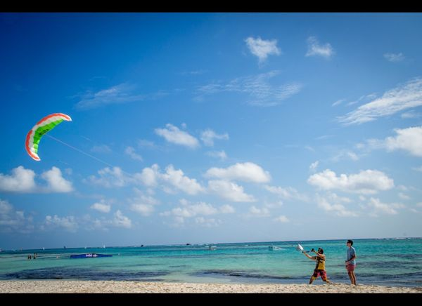Kite Fest attendees practice kite surfing on Playa Blanca