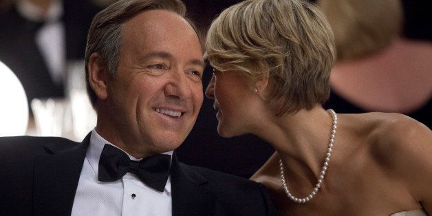 """This image released by Netflix shows Kevin Spacey as U.S. Congressman Frank Underwood, left, and Robin Wright as Claire Underwood in a scene from the Netflix original series, """"House of Cards."""" The new original series arrived in one big helping _ all 13 episodes of its first season _ on the subscription streaming service on Friday, Feb. 1, 2013, for viewers to enjoy, at their leisure, in the weeks, months or even years to come. (AP Photo/Netflix, Melinda Sue Gordon) (AP Photo/Netflix)"""