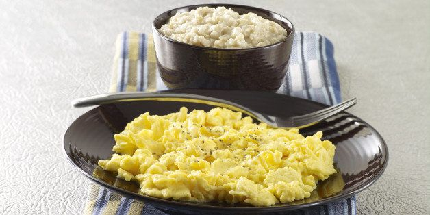 A plate of scrambled eggs and bowl of oatmeal