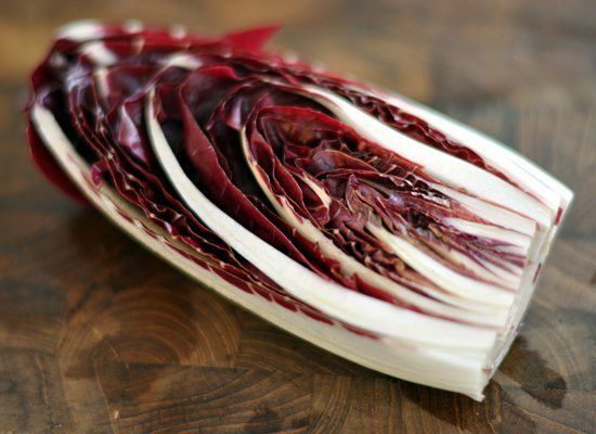 Radicchio is Italian in origin. The lettuce is characterized by dark red leaves with bright white stems on a tightly packed h