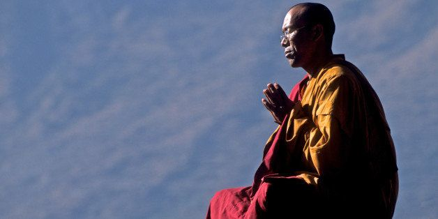 Tibetan Buddhist monk praying for world peace, Godegeng, Nepal