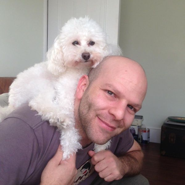 Husband and our toy poodle, Pinky.