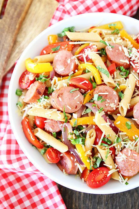 "<strong>Get the <a href=""http://www.twopeasandtheirpod.com/spicy-sausage-and-pepper-pasta/"" target=""_blank"">Spicy Sausage and"